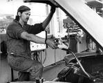 Student Working on Car, 1973